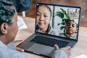 A teacher doing an online tutoring session on laptop